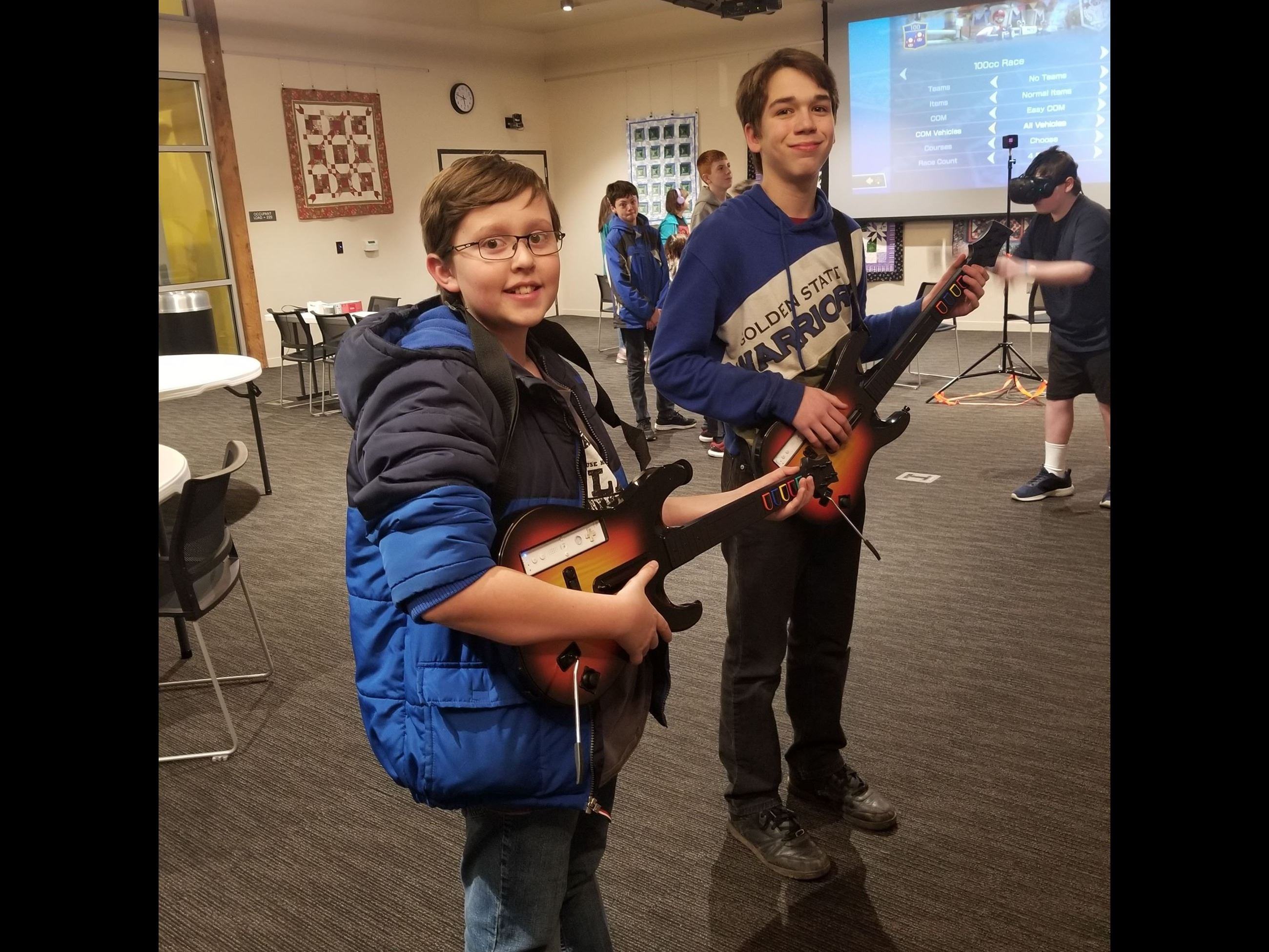 Teens rock out with Guitar Hero