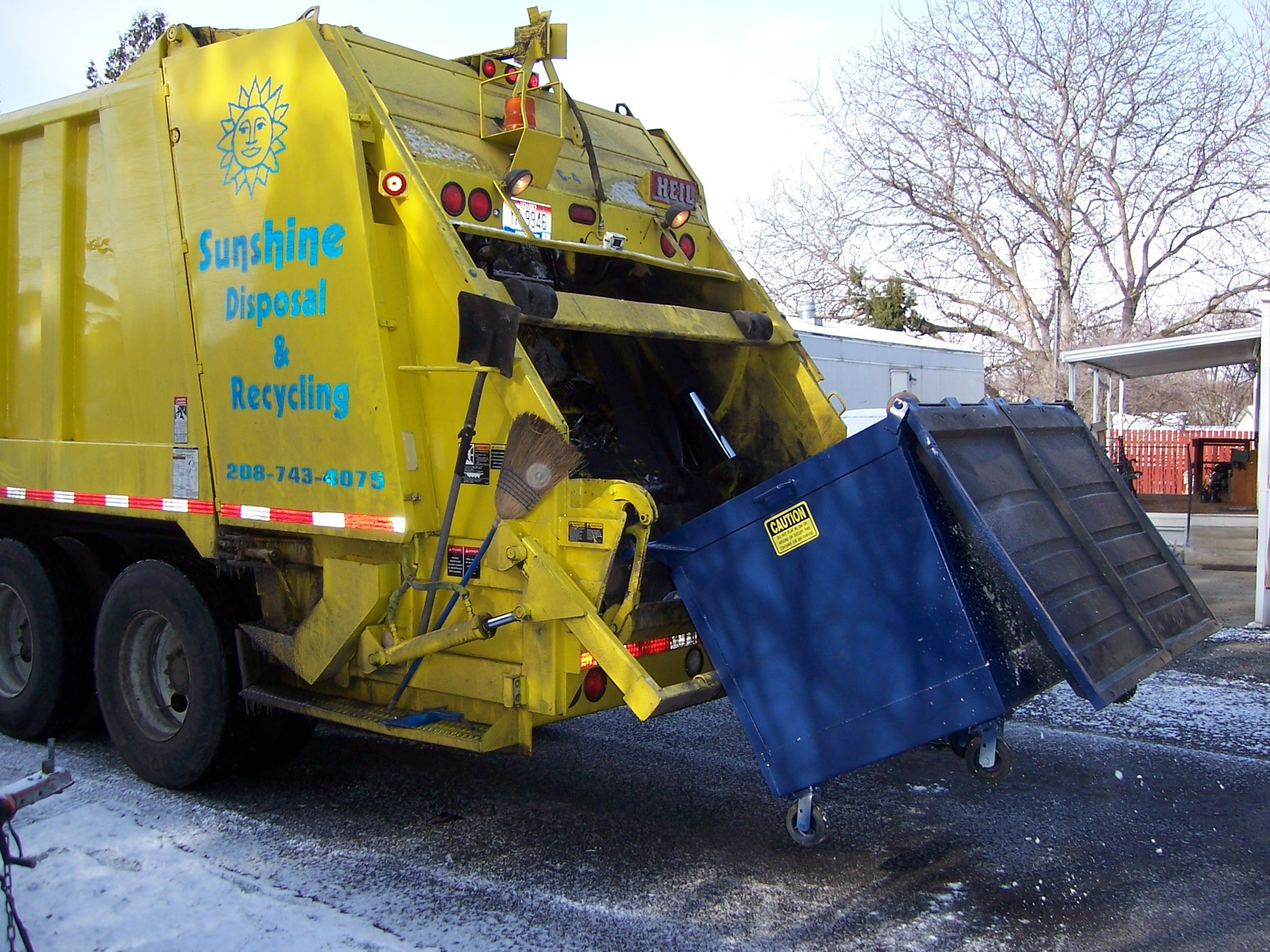 Garbage Truck Emptying a Dumpster